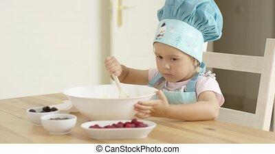 Adorable toddler at mixing bowl - Adorable single toddler in...