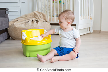 Adorable toddler boy looking at toilet baby pot - Adorable ...