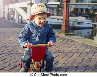 Adorable toddler on a tricycle