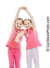Adorable twin girls fun held hands