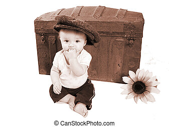 Vintage baby by a antique trunk