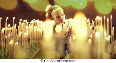 Adorable woman among milions of candles - Adorable blonde...