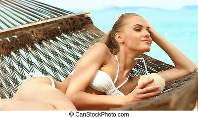 Adorable woman laying and drinking