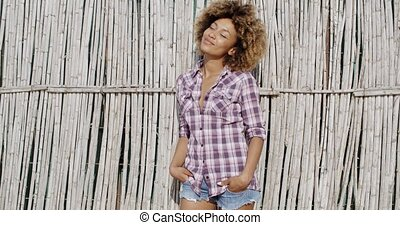 Adorable Woman Posing Against Wall