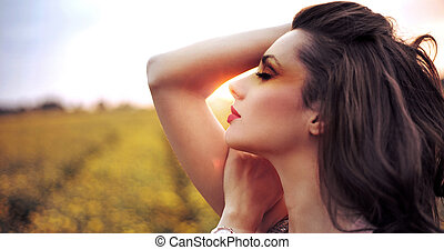 Adorable woman resting on the corn field - Adorable woman...