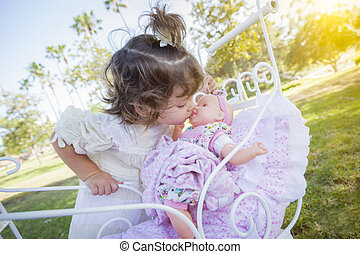 Adorable Young Baby Girl Playing with Baby Doll and Carriage...