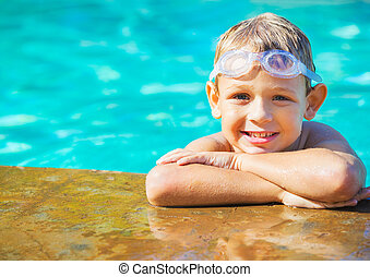 Young Boy Having fun at the Pool