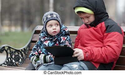 Adorable young boy watching his brother