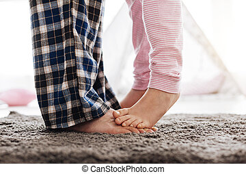 Adorable young girl dancing with her dad - Little feet....