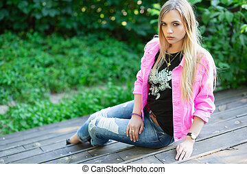 Adorable young woman posing on the street.