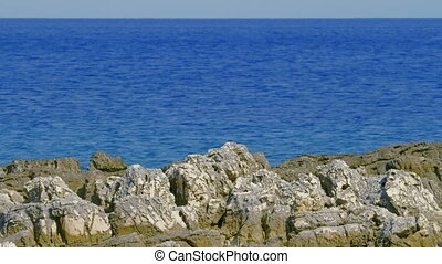 Adriatic landscape (rocks and sea) with horizon and copy...