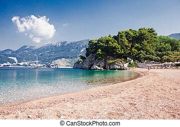 Adriatic seashore with rocks and pebble, St. Stefan, Montenegro