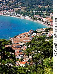 Adriatic town of Baska vertical aerial view, Krk island, Croatia