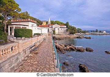 Adriatic town of Opatija watefront walkway and church view, ...