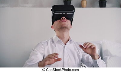 Adult american man uses excitement network device of augmented reality. Cyber innovation for happy gamer, corporate game score and technology connection. Creative simulator for new futuristic generation.