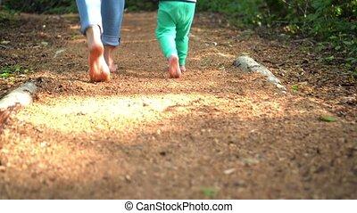 Adult and children feet barefoot walk on sensory path ...