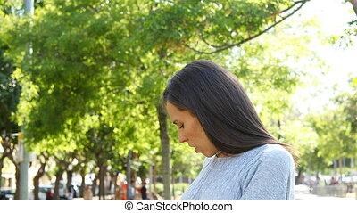 Adult asmathic woman using asthma inhaler - Adult asmathic...