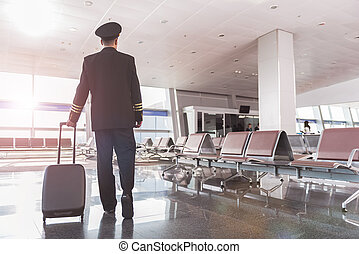 Adult aviator ready for flight - Pilot is walking through ...