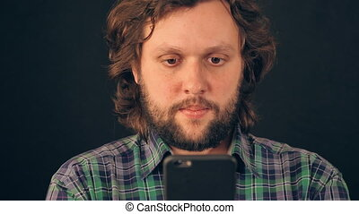 adult caucasian guy messaging on mobile - portrait cheerful...
