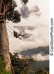 Adult Caucasian Man Swinging On A Swing In Banos De Agua...