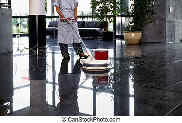 Adult cleaner maid woman with uniform cleaning corridor pass...
