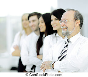 adult confident businessman on background of business team