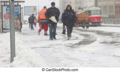 Adult couple commuting to work during storm - Senior couple...