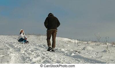fun with a sledge on snow
