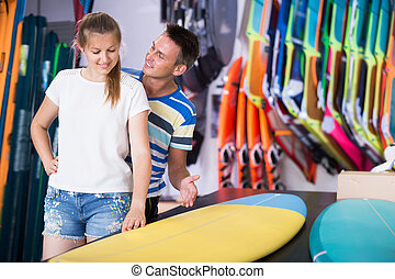 Adult couple is choosing colorful boards