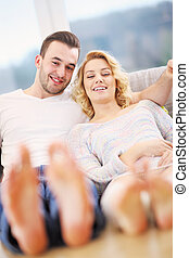 Adult couple relaxing at home