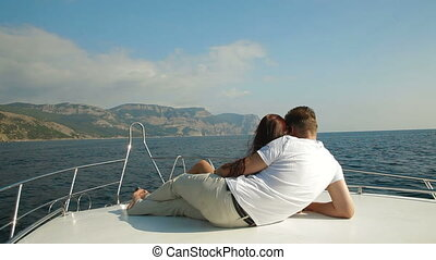 Couple Relaxing on a Speedboat - Adult Couple Relaxing on a...