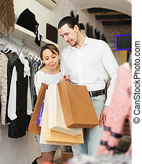Adult couple with shopping bags