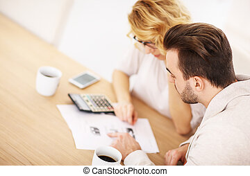 Adult couple working on documents