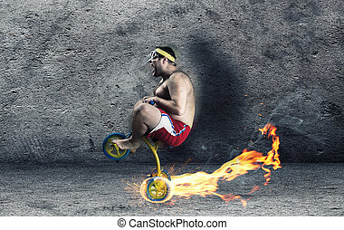 Adult crazy man cycling on child's bicycle