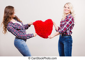 adult daughter and mother with heart love sign