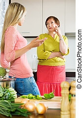 Adult daughter  fighting with upset mature mother
