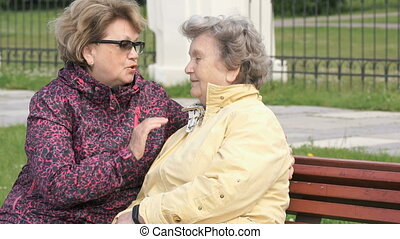 Adult daughter soothes old mother during stress - Adult...