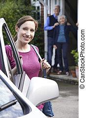 Adult Daughter Visiting Senior Parents At Home