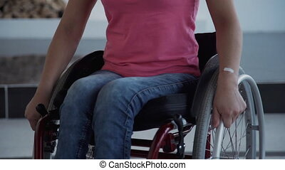 Woman in comfort wheelchair spin around on holding hands on...