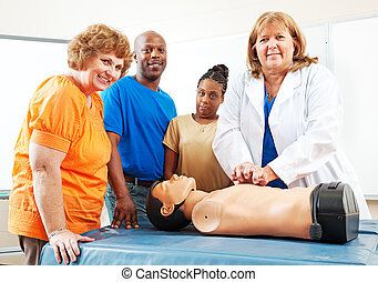 Adult Education Students Learning First Aid - Adult students...