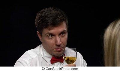 adult elegant man hold glass of wine, close up, indoor shot, selective focus. Close up, Slow motion