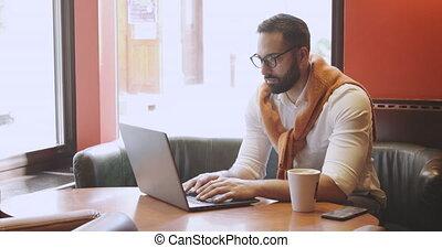 Adult Entrepreneur in Cafe - Adult bearded man dressed in...
