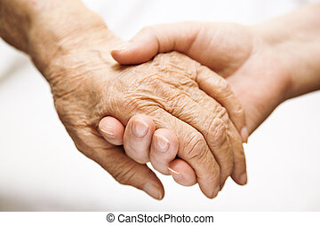 adult helping senior in hospital - help concept, special ...