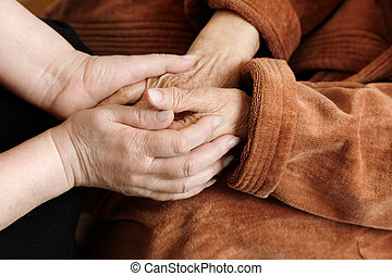 adult helping senior - help concept with hands of women,...