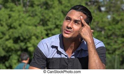 Adult Hispanic Man Thinking
