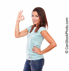 Adult hispanic woman with ok sign