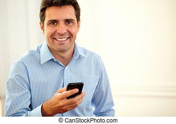Adult latin businessman smiling at you