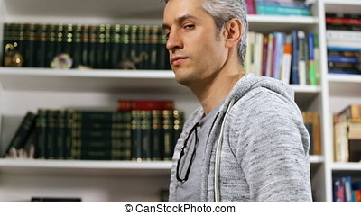 Adult looking at a library and raising the thumb to camera