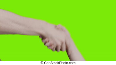 adult male and teen female hands handshake over green screen, 4k prores hq footage