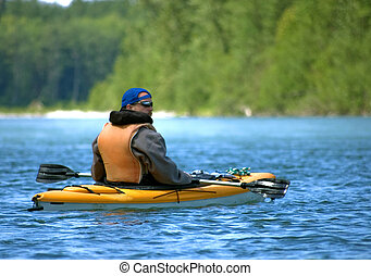 Adult Male Enjoying a Water Sport - Young adult man is ...